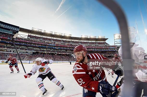 Mike Green of the Washington Capitals and Marian Hossa of the Chicago Blackhawks skate around the boards during the 2015 Bridgestone NHL Winter...