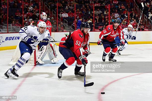 Mike Green of the Washington Capitals battles for the puck against James van Riemsdyk of the Toronto Maple Leafs in the third period during an NHL...