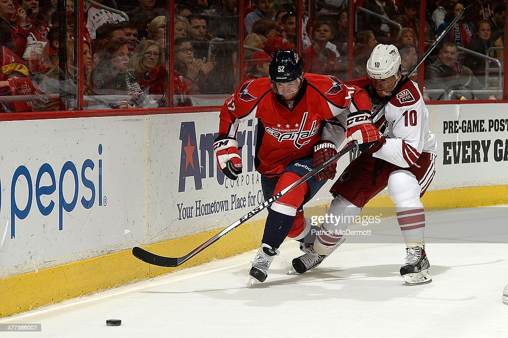 Mike Green #52 of the Washington Capitals battles for the puck against <a gi-track='captionPersonalityLinkClicked' href=/galleries/search?phrase=Martin+Erat&family=editorial&specificpeople=210561 ng-click='$event.stopPropagation()'>Martin Erat</a> #10 of the Phoenix Coyotes in the third period during an NHL game at Verizon Center on March 8, 2014 in Washington, DC.