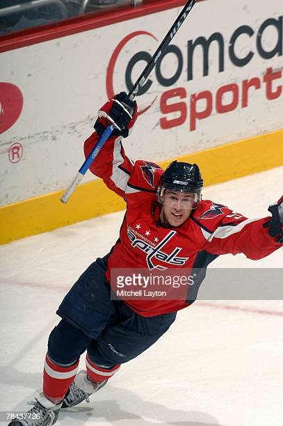 Mike Green of the Washington Capitals celebrates scoring over time goal during a hockey game against the New York Rangers on December 12 2007 at the...