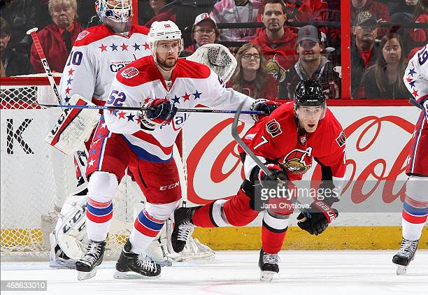 Mike Green of the Washington Capitals checks Kyle Turris of the Ottawa Senators at Canadian Tire Centre on April 4 2015 in Ottawa Ontario Canada