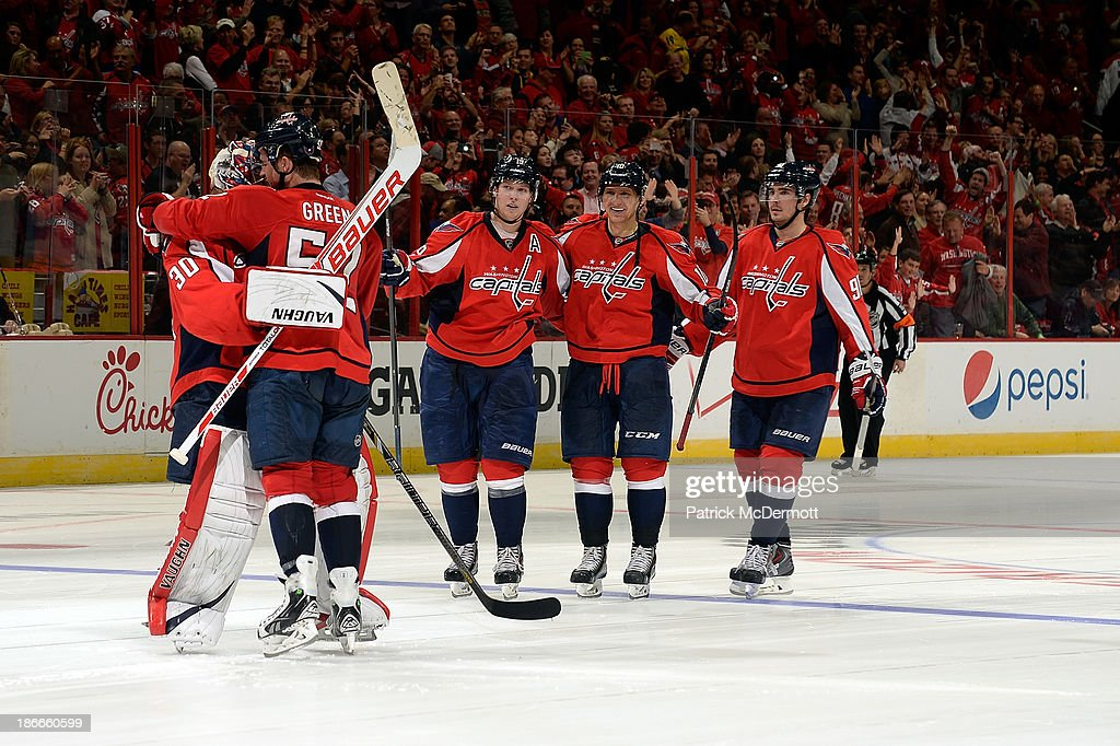 Mike Green #52 of the Washington Capitals congratulates <a gi-track='captionPersonalityLinkClicked' href=/galleries/search?phrase=Michal+Neuvirth&family=editorial&specificpeople=3205600 ng-click='$event.stopPropagation()'>Michal Neuvirth</a> #30 after the Capitals defeated the Florida Panthers 3-2 in a shootout at Verizon Center on November 2, 2013 in Washington, DC.