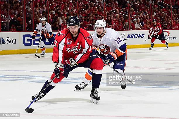 Mike Green of the Washington Capitals controls the puck against Josh Bailey of the New York Islanders during the third period in Game Two of the...