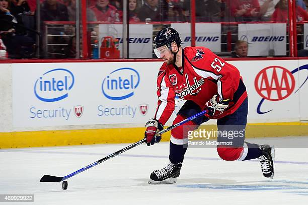 Mike Green of the Washington Capitals controls the puck against the New York Islanders during the first period in Game One of the Eastern Conference...