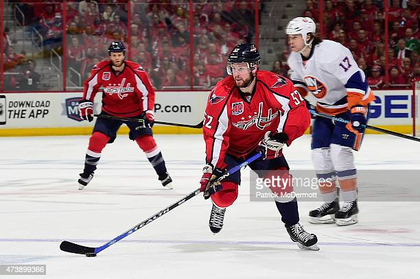 Mike Green of the Washington Capitals controls the puck against the New York Islanders during the second period in Game Seven of the Eastern...
