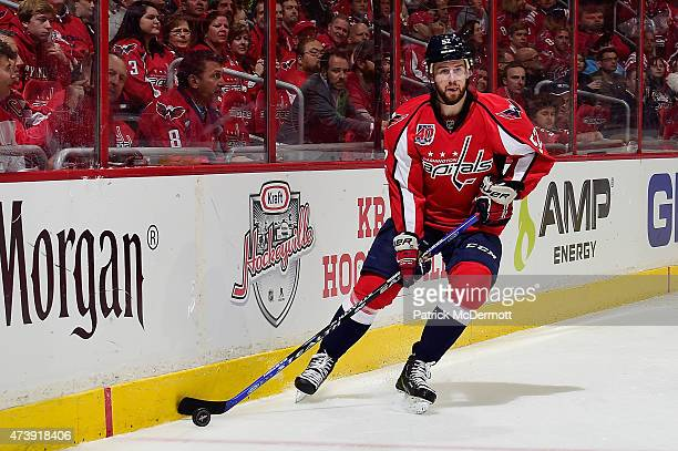 Mike Green of the Washington Capitals controls the puck against the New York Islanders during the first period in Game Five of the Eastern Conference...