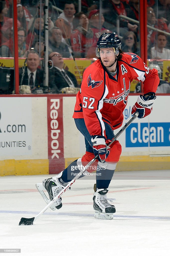 <a gi-track='captionPersonalityLinkClicked' href=/galleries/search?phrase=Mike+Green&family=editorial&specificpeople=208647 ng-click='$event.stopPropagation()'>Mike Green</a> #52 of the Washington Capitals handles the puck during the second period of an NHL hockey game at Verizon Center on January 22, 2013 in Washington, DC.