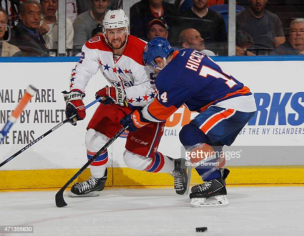 Mike Green of the Washington Capitals is checked by Thomas Hickey of the New York Islanders in Game Six of the Eastern Conference Quarterfinals...