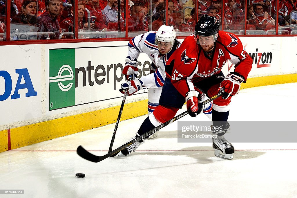 Mike Green #52 of the Washington Capitals looks to clear the puck in the third period of Game One of the Eastern Conference Quarterfinals against the Washington Capitals during the 2013 NHL Stanley Cup Playoffs at Verizon Center on May 2, 2013 in Washington