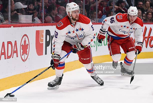Mike Green of the Washington Capitals looks to pass the puck against the Montreal Canadiens in the NHL game at the Bell Centre on April 2 2015 in...