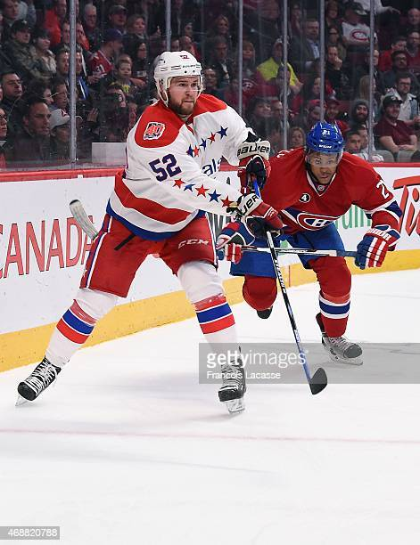Mike Green of the Washington Capitals passes the puck against the Montreal Canadiens in the NHL game at the Bell Centre on April 2 2015 in Montreal...