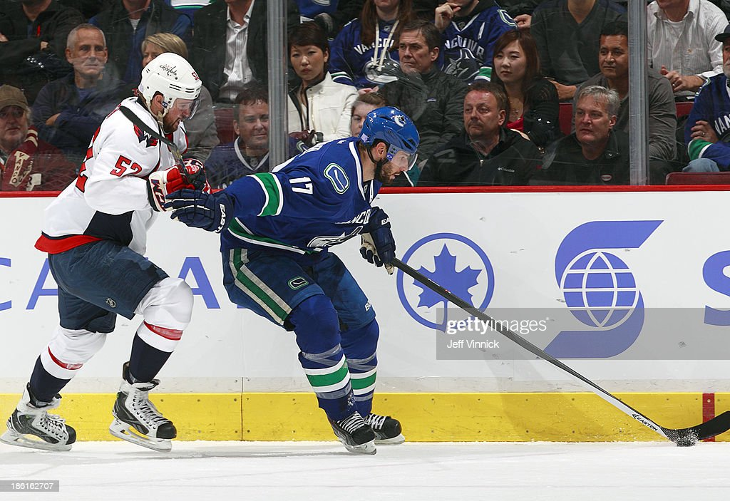 Mike Green #52 of the Washington Capitals pursues <a gi-track='captionPersonalityLinkClicked' href=/galleries/search?phrase=Ryan+Kesler&family=editorial&specificpeople=206915 ng-click='$event.stopPropagation()'>Ryan Kesler</a> #17 of the Vancouver Canucks during their NHL game at Rogers Arena on October 28, 2013 in Vancouver, British Columbia, Canada.