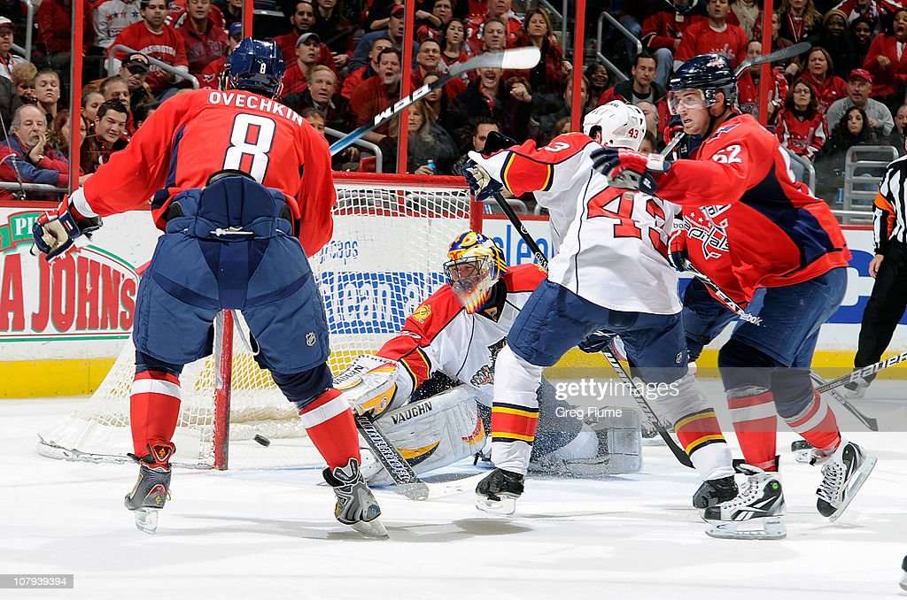 Mike Green of the Washington Capitals scores a goal in the third period against Scott Clemmensen of the Florida Panthers at the Verizon Center on...