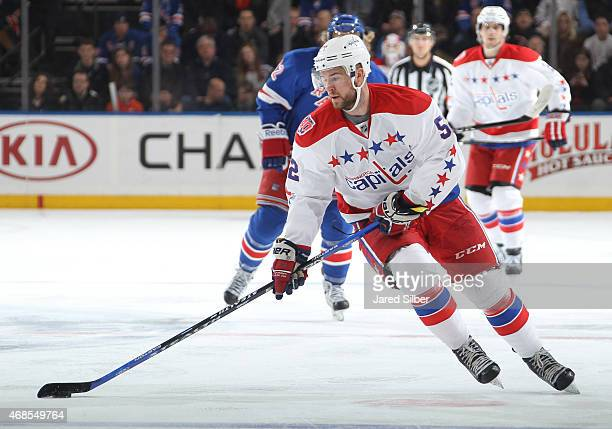 Mike Green of the Washington Capitals skates with the puck against the New York Rangers at Madison Square Garden on March 29 2015 in New York City...