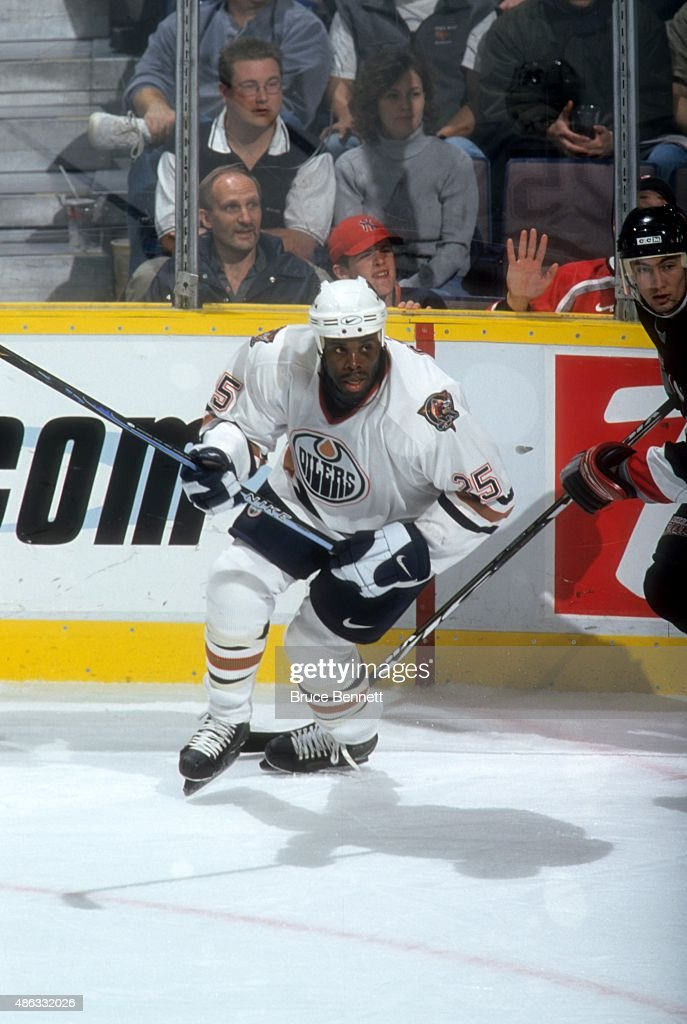 Mike Grier of the Edmonton Oilers skates on the ice during an NHL game against the Buffalo Sabres on October 13 2000 at the Rexall Place in Edmonton...