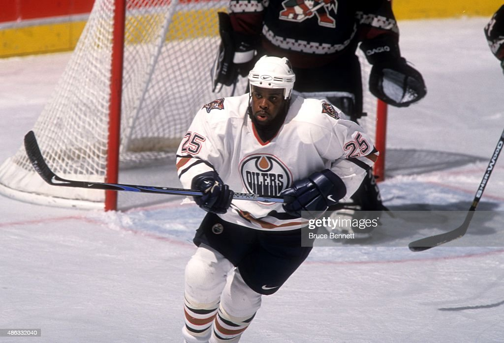 Mike Grier of the Edmonton Oilers skates on the ice during an NHL game against the Phoenix Coyotes on October 22 2000 at the Rexall Place in Edmonton...