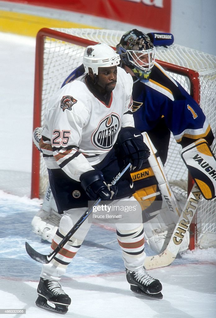 Mike Grier of the Edmonton Oilers tries to screen goalie Roman Turek of the St Louis Blues on November 14 2000 at the Rexall Place in Edmonton...