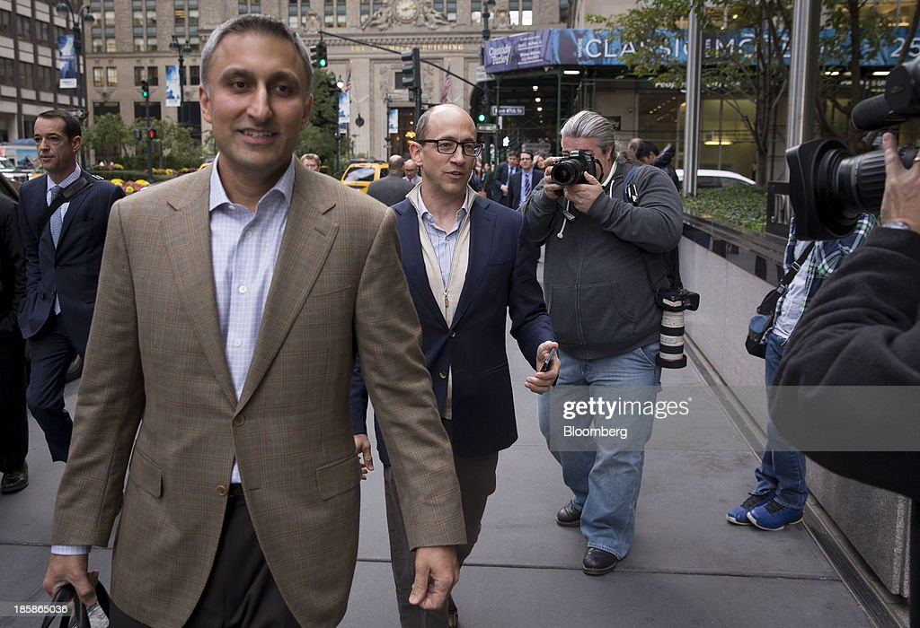 Mike Gupta, chief financial officer of Twitter Inc., left, and Richard 'Dick' Costolo, chief executive officer of Twitter Inc., center, arrive at JPMorgan Chase & Co. headquarters in New York, U.S., on Friday, Oct. 25, 2013. Twitter Inc. will make the case to potential investors in its initial public offering that it needs to keep spending to grow, and profit will come once it can reap the benefits of those investments. Photographer: Scott Eells/Bloomberg via Getty Images