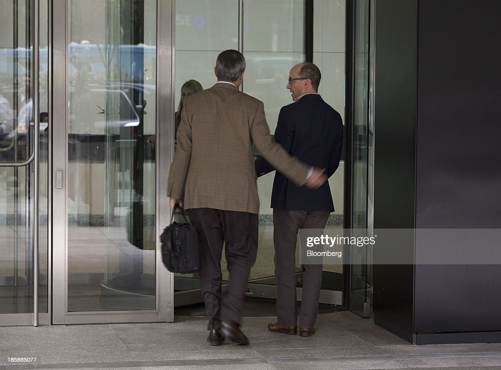 Mike Gupta, chief financial officer of Twitter Inc., left, and Richard 'Dick' Costolo, chief executive officer of Twitter Inc., arrive at JPMorgan Chase & Co. headquarters in New York, U.S., on Friday, Oct. 25, 2013. Twitter Inc. will make the case to potential investors in its initial public offering that it needs to keep spending to grow, and profit will come once it can reap the benefits of those investments. Photographer: Scott Eells/Bloomberg via Getty Images