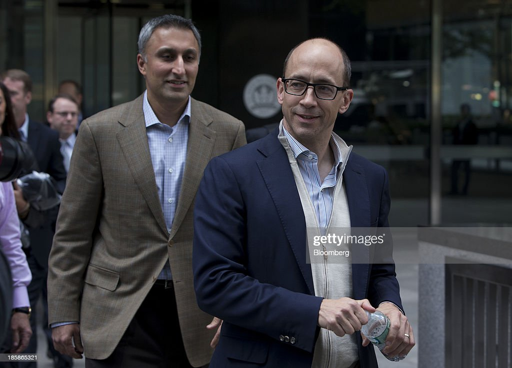 Mike Gupta, chief financial officer of Twitter Inc., left, and Richard 'Dick' Costolo, chief executive officer of Twitter Inc., exit JPMorgan Chase & Co. headquarters in New York, U.S., on Friday, Oct. 25, 2013. Twitter Inc. will make the case to potential investors in its initial public offering that it needs to keep spending to grow, and profit will come once it can reap the benefits of those investments. Photographer: Scott Eells/Bloomberg via Getty Images