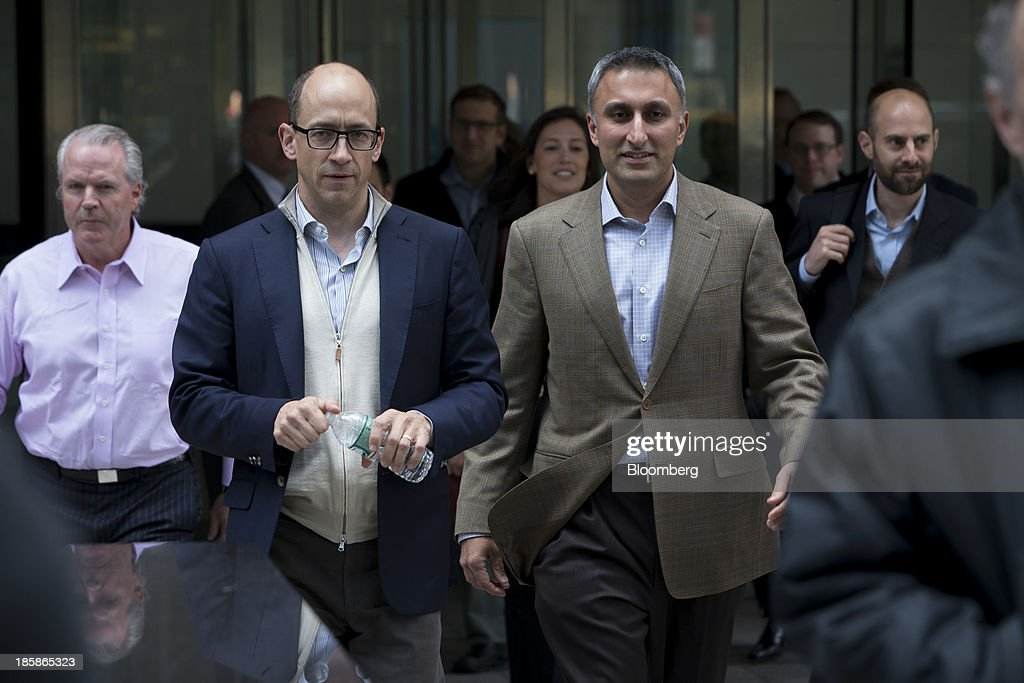Mike Gupta, chief financial officer of Twitter Inc., right, and Richard 'Dick' Costolo, chief executive officer of Twitter Inc., left, exit JPMorgan Chase & Co. headquarters in New York, U.S., on Friday, Oct. 25, 2013. Twitter Inc. will make the case to potential investors in its initial public offering that it needs to keep spending to grow, and profit will come once it can reap the benefits of those investments. Photographer: Scott Eells/Bloomberg via Getty Images