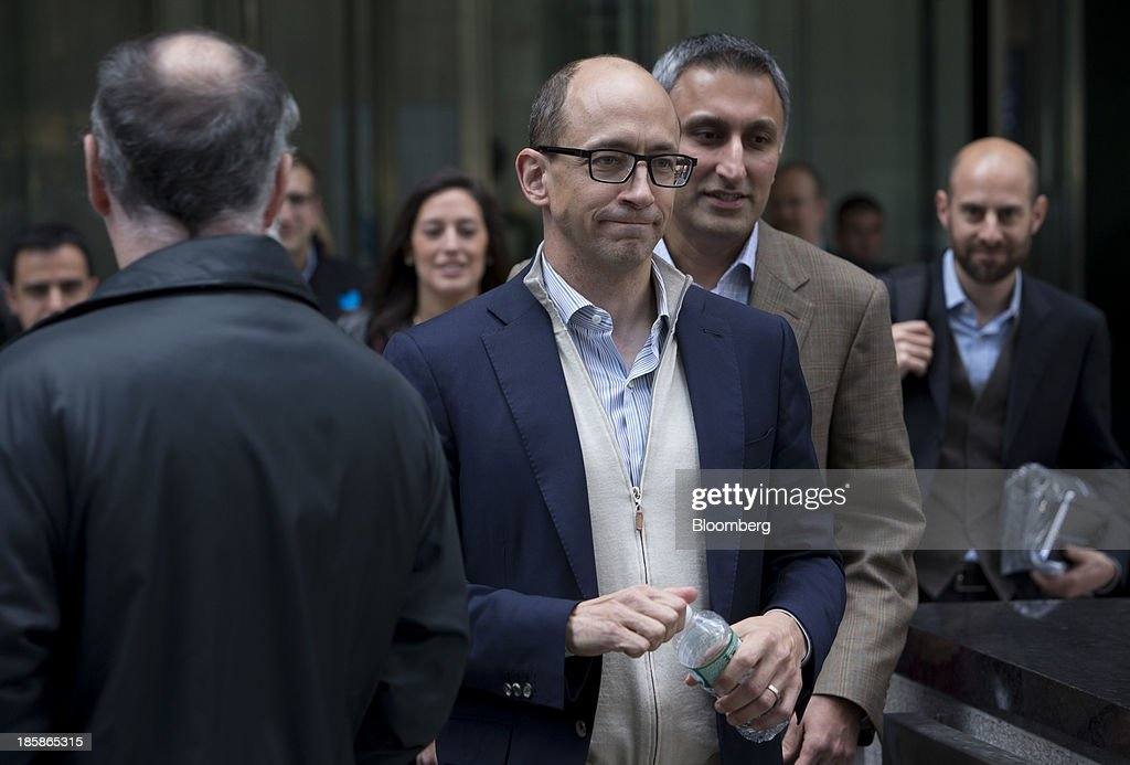 Mike Gupta, chief financial officer of Twitter Inc., second right, and Richard 'Dick' Costolo, chief executive officer of Twitter Inc., center, exit JPMorgan Chase & Co. headquarters in New York, U.S., on Friday, Oct. 25, 2013. Twitter Inc. will make the case to potential investors in its initial public offering that it needs to keep spending to grow, and profit will come once it can reap the benefits of those investments. Photographer: Scott Eells/Bloomberg via Getty Images