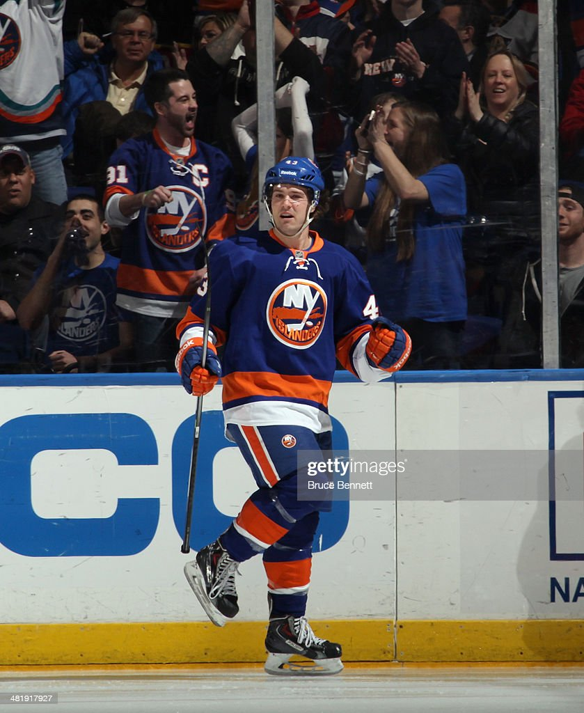 Mike Halmo #43 of the New York Islanders celebrates his first NHL goal at 4:21 of the third period against the Florida Panthers at the Nassau Veterans Memorial Coliseum on April 1, 2014 in Uniondale, New York. The Islanders defeated the Panthers 4-2.
