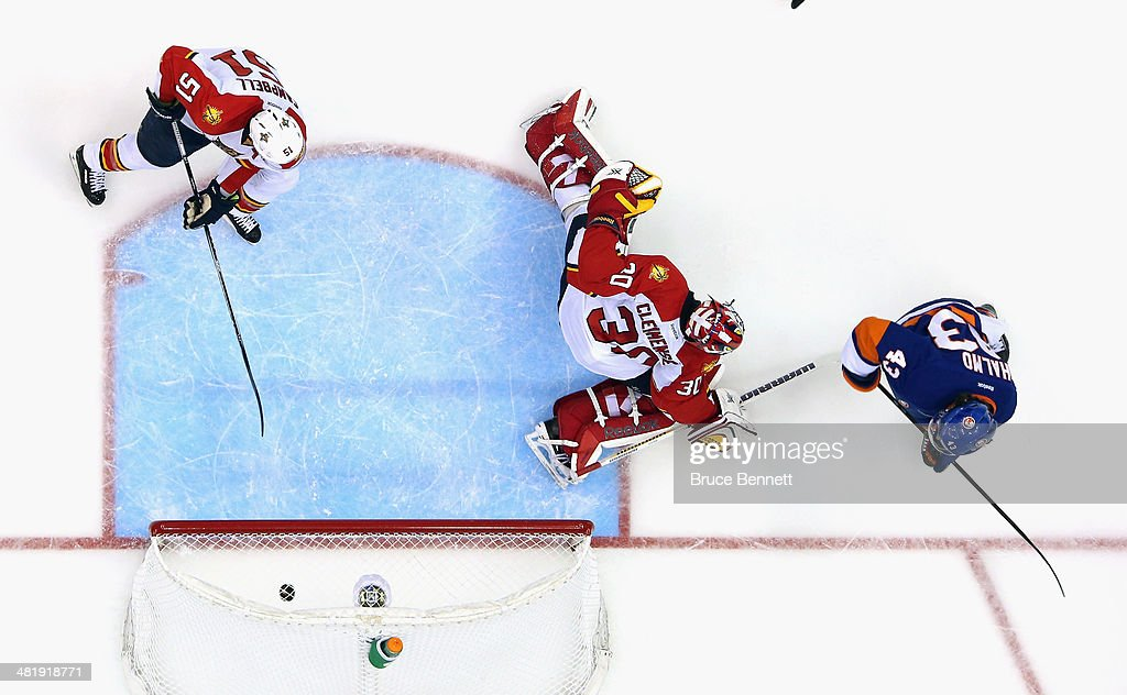 Mike Halmo #43 of the New York Islanders scores his first NHL goal at 4:21 of the third period against Scott Clemmensen #30 of the Florida Panthers at the Nassau Veterans Memorial Coliseum on April 1, 2014 in Uniondale, New York. The Islanders defeated the Panthers 4-2.