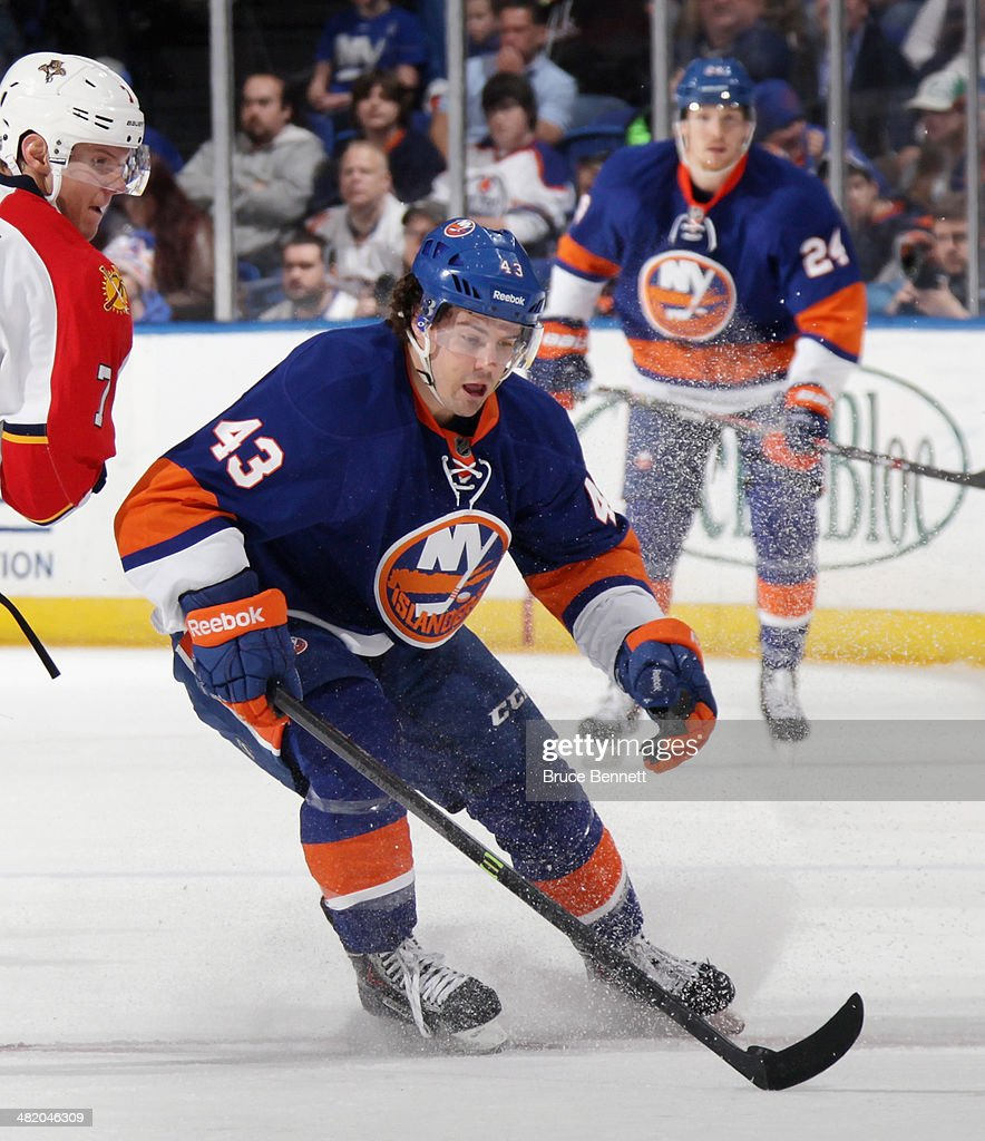 Mike Halmo #43 of the New York Islanders skates against the Florida Panthers at the Nassau Veterans Memorial Coliseum on April 1, 2014 in Uniondale, New York. The Islanders defeated the Panthers 4-2.