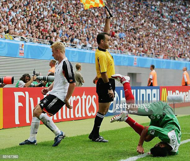 Mike Hanke of Germany receives after a foul on Carlos Salcido of Mexico the Red card by the referee Matthew Breeze of Australia during the game...