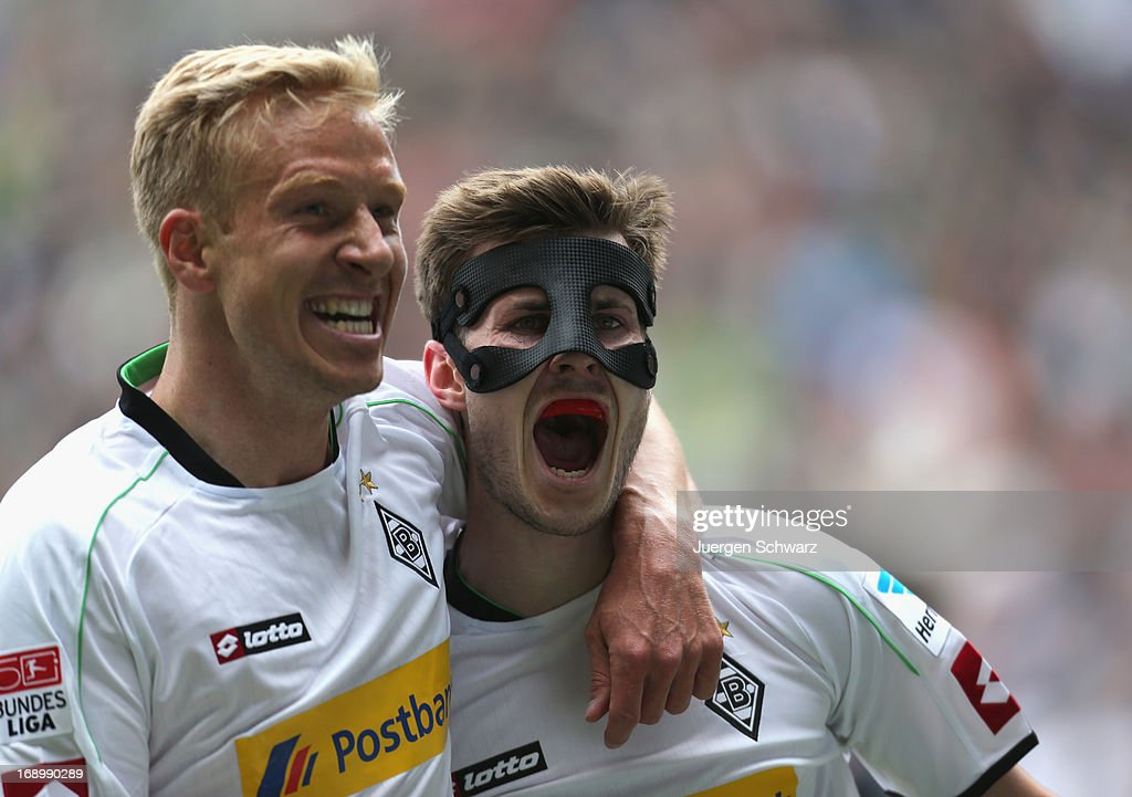<a gi-track='captionPersonalityLinkClicked' href=/galleries/search?phrase=Mike+Hanke&family=editorial&specificpeople=206515 ng-click='$event.stopPropagation()'>Mike Hanke</a> of Moenchengladbach (L) and Havard Nordveit celebrate after scoring during the Bundesliga match between Borussia Moenchengladbach and Bayern Muenchen at Borussia Park Stadium on May 18, 2013 in Moenchengladbach, Germany.