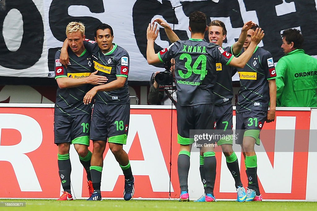 <a gi-track='captionPersonalityLinkClicked' href=/galleries/search?phrase=Mike+Hanke&family=editorial&specificpeople=206515 ng-click='$event.stopPropagation()'>Mike Hanke</a> (L) of Moenchengladbach celebrates his team's fourth goal with team mates during the Bundesliga match between 1. FSV Mainz 05 and VfL Borussia Moenchengladbach at Coface Arena on May 11, 2013 in Mainz, Germany.