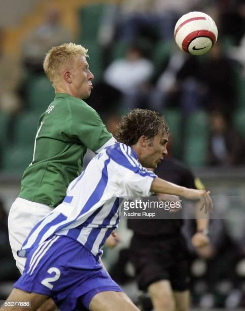 Mike Hanke of Wolfsburg competes with Mattias Karl Svensson of Goteborg during the UEFA Intertoto Cup third round match between VFL Wolfsburg and IFK...