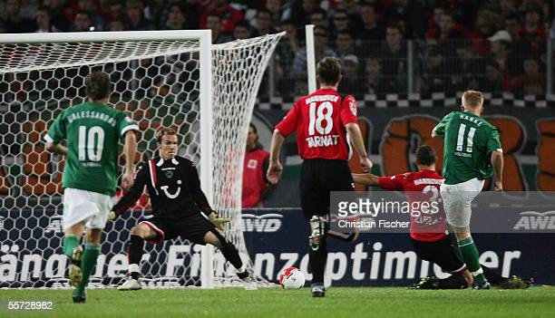 Mike Hanke of Wolfsburg scores the first goal against Hannover during the Bundesliga match between Hanover 96 and VfL Wolfsburg at the AWD Arena on...