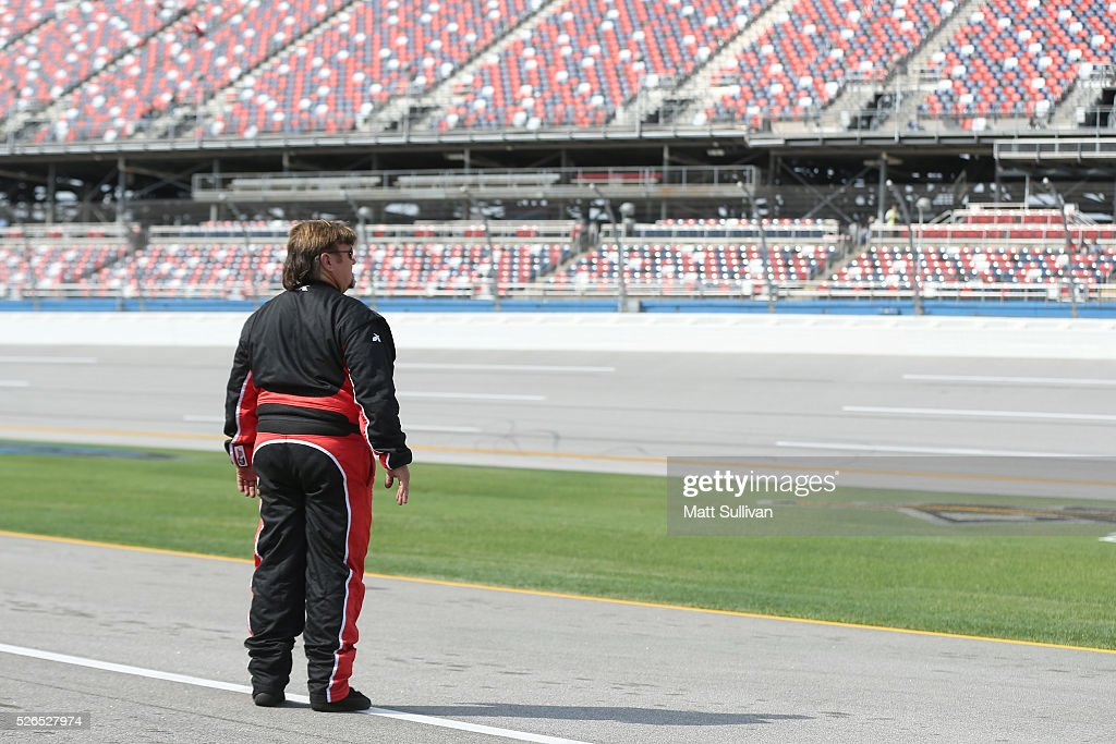 Mike Harmon, driver of the #74 Multiple Sclerosis Society Dodge, stands on the grid during qualifying for the NASCAR XFINITY Series Sparks Energy 300 at Talladega Superspeedway on April 30, 2016 in Talladega, Alabama.
