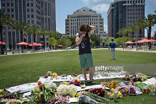 Mike Harrett visits a makeshift memorial outside the Dr Phillips Center for the Performing Arts for the mass shooting victims at the Pulse nightclub...