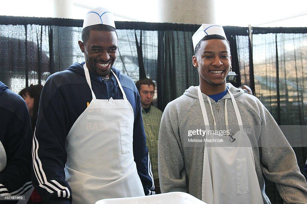 Mike Harris #33 and Trey Burke #3 of the Utah Jazz during the we care-we share Thanksgiving Dinner feeding the homeless at EnergySolutions Arena on November 27, 2013 in Salt Lake City, Utah.