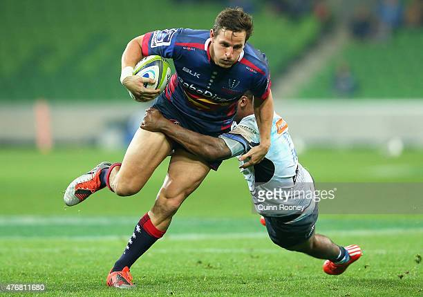 Mike Harris of the Rebels is tackled by Marcel Brache of the Force during the round 18 Super Rugby match between the Rebels and the Force at AAMI...
