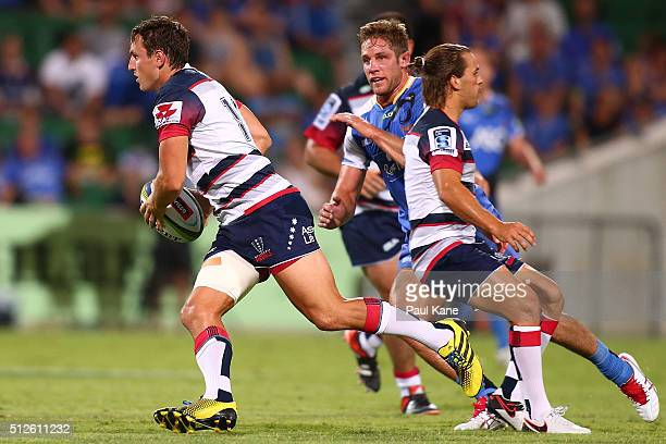 Mike Harris of the Rebels makes a break during the round one Super Rugby match between the Force and the Rebels at nib Stadium on February 27 2016 in...