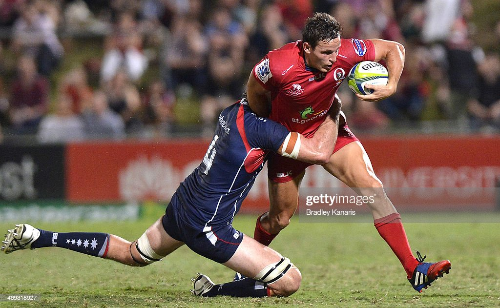 Mike Harris of the Reds attempts to break away from the defence during the Super Rugby trial match between the Queensland Reds and the Melbourne Rebels at Ballymore Stadium on February 14, 2014 in Brisbane, Australia.