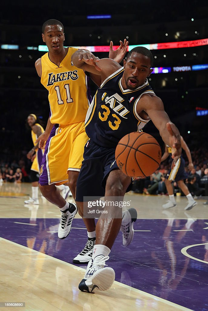 Mike Harris #33 of the Utah Jazz lunges for a loose ball while defended by Wesley Johnson #11 of the Los Angeles Lakers in the first half at Staples Center on October 22, 2013 in Los Angeles, California.