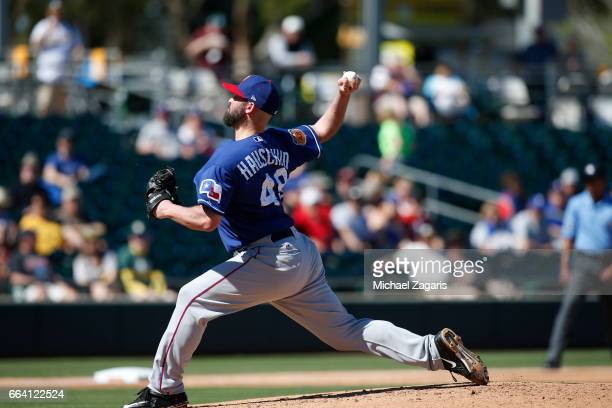Mike Hauschild of the Texas Rangers pitches during the game against the Oakland Athletics at Hohokam Stadium on March 2 2017 in Mesa Arizona