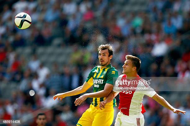 Mike Havenaar of ADO Den Haag challenges for the headed ball with Joel Veltman of Ajax during the Dutch Eredivisie match between Ajax Amsterdam and...