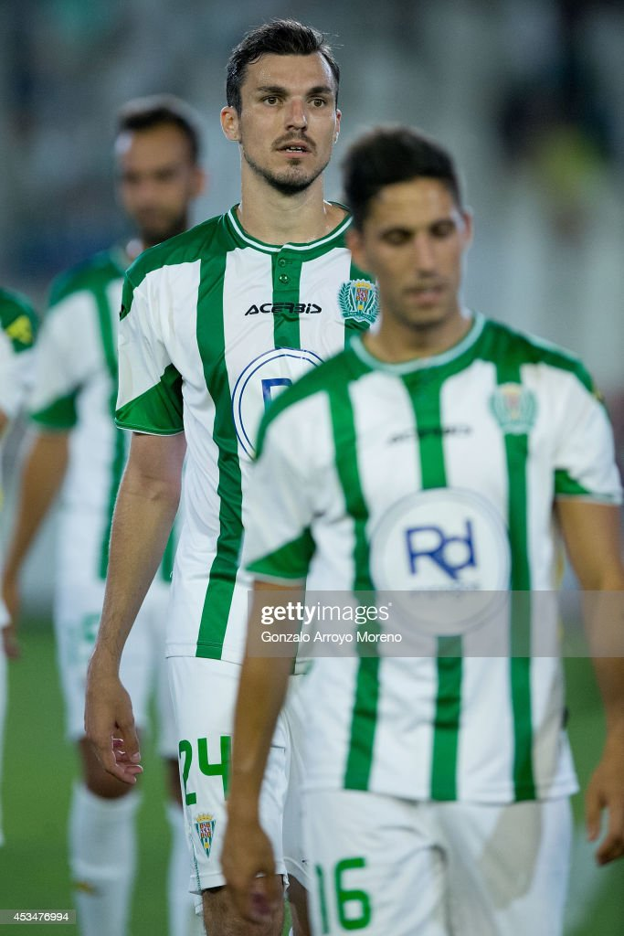 Mike Havenaar of Cordoba CF leaves the pitch behind his teammate Fidel Chaves after the pre season friendly match between Cordoba CF and Raja de...