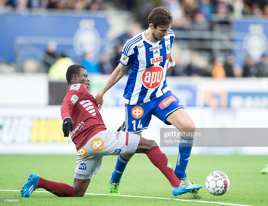 Mike Havenaar of HJK Helsinki and Didier Boris Kadio compete for the ball during the Finnish First Division match between HJK Helsinki and FF Jaro at Sonera Stadium on May 3, 2015 in Helsinki, Finland.