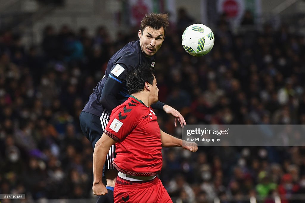 Mike Havenaar of Japan heads the ball to assist Japan's fifth goal during the FIFA World Cup Russia Asian Qualifier second round match between Japan...