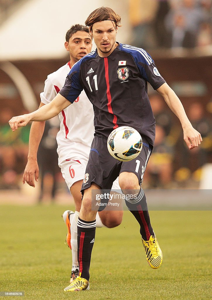 <a gi-track='captionPersonalityLinkClicked' href=/galleries/search?phrase=Mike+Havenaar&family=editorial&specificpeople=776229 ng-click='$event.stopPropagation()'>Mike Havenaar</a> of Japan in action during the FIFA World Cup Asian qualifier match between Jordan and Japan at King Abdullah International Stadium on March 26, 2013 in Amman, Jordan.