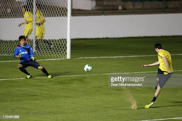 Mike Havenaar of Japan shoots on goal as goal keeper Shusaku Nishikawa attempts the save during the Japan Training Session at Walmir Campelo Bezerra...