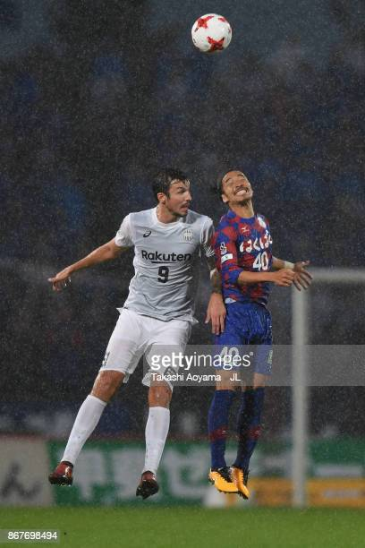 Mike Havenaar of Vissel Kobe and Shohei Ogura of Ventforet Kofu compete for the ball during the JLeague J1 match between Ventforet Kofu and Vissel...