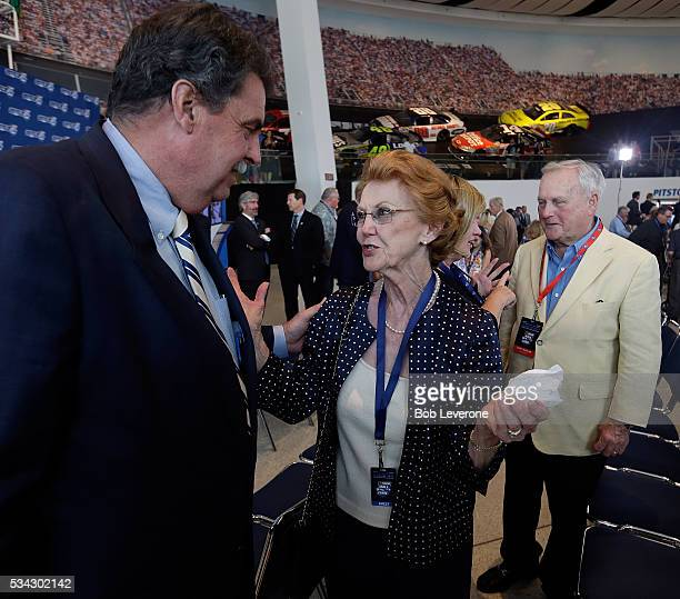 Mike Helton NASCAR vice chairman listens as Violet Parks widow of driver Raymond Parks describes her gratitude at NASCAR Hall of Fame voters choosing...